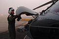 US Navy 060113-N-9866B-004 Lt. Jessica Parker, a MH-60S Seahawk helicopter pilot, assigned the Black Jacks of Helicopter Sea Combat Squadron Two One (HSC-21), conducts a pre-flight check.jpg