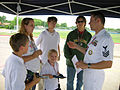US Navy 060508-N-8374E-015 A South Garland High School student and his family consider Navy career options explained by Fire Controlman 1st Class Gabriel DeLaPaz.jpg