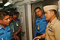 US Navy 060606-N-4124C-043 Chief Electrician's Mate Noel Corneja, assigned to the Avenger-class Mine Warfare Ship USS Patriot (MCM 7), gives a tour of his ship to Sailors of mine countermeasures ships.jpg