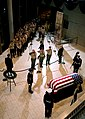 US Navy 070102-F-8535W-276 The casket of former President Gerald R. Ford is saluted during a memorial and repose ceremony at the Gerald R. Ford Museum in Grand Rapids.jpg