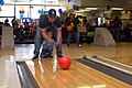 US Navy 070210-N-6081J-282 Senior Chief Gas Turbine System Technician Mike Wroten, assigned to guided missile destroyer USS Bainbridge (DDG 96), helps his son bowl at the Big Brothers Big Sisters of South Hampton Roads.jpg