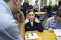 US Navy 070327-N-0426B-042 Hospital Corpsman 3rd Class Tyson Riccio, a lab technician aboard amphibious transport dock USS Nashville (LPD 13), explains to a Sailor the four areas of her cheek to swab to properly collect DNA sam.jpg
