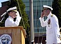 US Navy 070711-N-3390M-001 Rear Adm. William French and Rear Adm. James Symonds exchange salutes during the Navy Region Northwest change of command ceremony held at Naval Station Everett.jpg