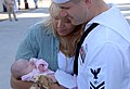 US Navy 070930-N-8421M-073 Electronics Technician 2nd Class Shawn Seever, from Shell Lake, Wis., greets his fiancée Dawn Prigge and seven-week-old baby after returning from deployment aboard USS Nimitz (CVN 68).jpg