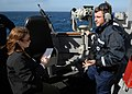 US Navy 080127-N-7981E-388 While standing watch aboard the USS Momsen (DDG 92), Boatswain's Mate Seaman Alden Fenton discusses some of the training he has received to help him spot and identify marine mammals with a journalist.jpg