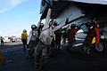 US Navy 080630-N-4009P-693 Flight deck personnel push back an F-A-18C Hornet assigned to the.jpg