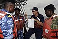 US Navy 080710-G-2443T-001 Lt. Richard Turrin, a member of the Coast Guard Auxiliary, translates boarding procedures.jpg