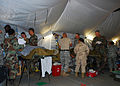 US Navy 080721-N-4973M-138 Army and Navy medical staff treat simulated patients inside the Camp Peguero Battle Aide Station during a mass casualty drill.jpg