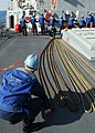 US Navy 081017-N-3483C-001 Sailors lay out lines during a replenishment at sea.jpg
