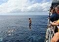 US Navy 081216-N-1082Z-065 Gunner's Mate 2nd Class Joshua McMullen jumps from USS Vella Gulf (CG 72) during a swim call.jpg