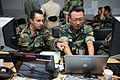 US Navy 090817-N-5086M-009 U.S. Navy Lt. Carlos Reyes, assigned to Naval Mine and Submarine Warfare Command San Diego, and Republic of Korea Navy Lt. Cmdr. Kim Seok-han of the work together as part of the Naval Operations Coord.jpg