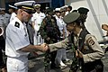 US Navy 090818-N-9123L-054 Chief Warrant Officer Terry Boone, from Houston, Texas greets an Indonesian police officer.jpg