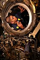 US Navy 090904-N-8119A-006 Machinist's Mate 3rd Class Anthony Roman inspects a torpedo tube for damage and foreign debris aboard the ballistic-missile submarine USS Henry M. Jackson (SSBN 730).jpg