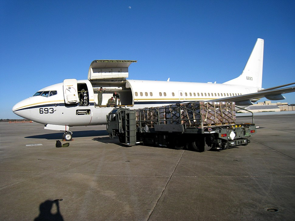 US Navy 100126-N-0705K-003 Naval Air Crewmen 2nd Class Nicole Garza and David Murray and Naval Air Crewman 1st Class David McDermott load cargo bound for Haiti at Naval Air Station Jacksonville