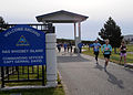 US Navy 100411-N-9860Y-002 Runners exit through Maui Gate at Naval Air Station (NAS) Whidbey Island Seaplane Base during the 9th Annual Whidbey Island Marathon-Half-Marathon.jpg