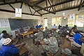 US Navy 100520-N-2221M-102 Uganda People's Defense Force (UPDF) soldiers, assisted by U.S. military and civilian personnel, meet with the Nkumba Quran Primary school headmistress Hadija Nantume and members of the school's manag.jpg