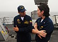 US Navy 100630-N-9301W-298 Lt. j.g. Amelia Abbett answers the questions of a visiting Colombian naval officer during a tour aboard the guided-missile frigate USS Klakring (FFG 42) during naval exercises off the coast of Peru.jpg