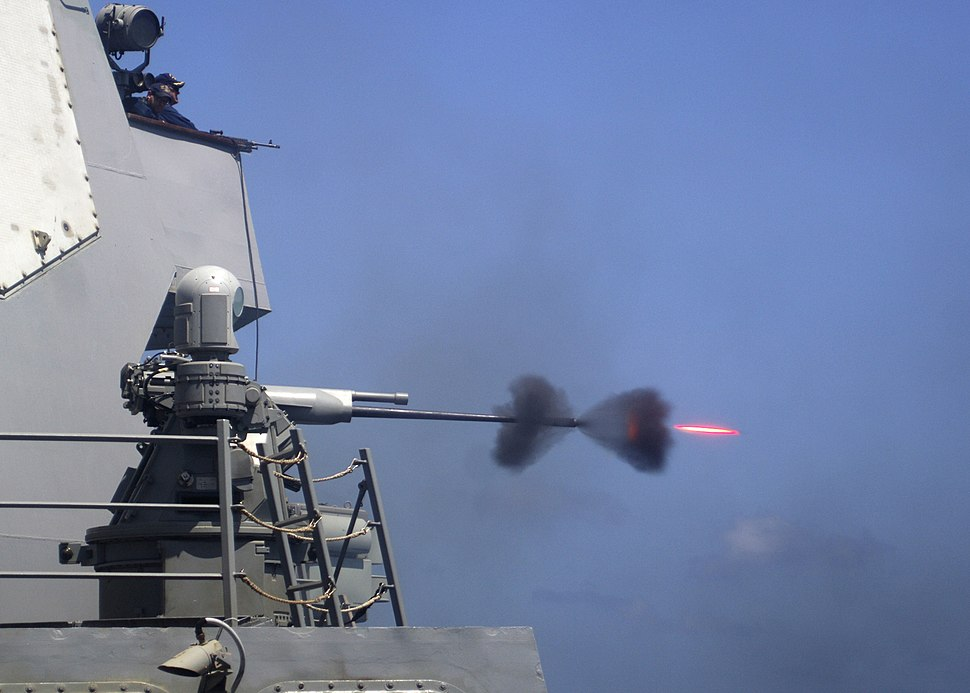 US Navy 110228-N-5838W-004 An MK-38 25mm gun system is fired during a live-fire exercise aboard the guided-missile destroyer USS Mason (DDG 87)