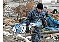 US Navy 110315-N-MU720-062 Mineman Seaman Jerad Clymer, from Houston, assigned to Naval Air Facility Misawa, removes debris from a park at the Misa.jpg