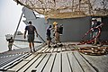US Navy 110611-N-WL435-079 A Sailor guides a U.S. Army diver down a bow ramp.jpg