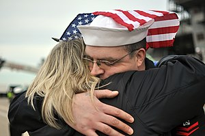 US Navy 111210-N-FU443-987 A Sailor hugs his wife following the ship's return to Naval Station Norfolk.jpg
