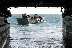 US Navy 111211-N-KS651-326 A landing craft utility departs the well deck of the amphibious dock landing ship USS Pearl Harbor (LSD 52).jpg
