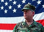 US Navy Adm. Leighton Smith is photographed as he stands before an American flag during US Independence day celebrations at the Allied Rapid Reaction Command Headquarters, in Sarajevo.jpg