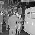 Uitslaande brand in de Spuistraat te Amsterdam, de heer De Ruiter voor onderzoek, Bestanddeelnr 917-2971.jpg