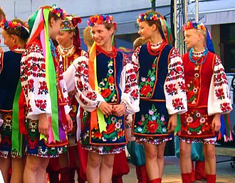 Cross-stitch - Ukrainian girls in traditional-style embroidered costumes
