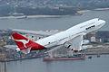 VH-OJA climbing after taking off from Sydney on its final flight.jpg