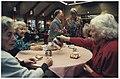 Veertig-jarig bestaan van Zorgcentrum de Blinkert. Enkele bewoners aan de koffie met cake in de recreatiezaal. In het midden staand directrice, mevr. van Gendt. NL-HlmNHA 54036443.JPG