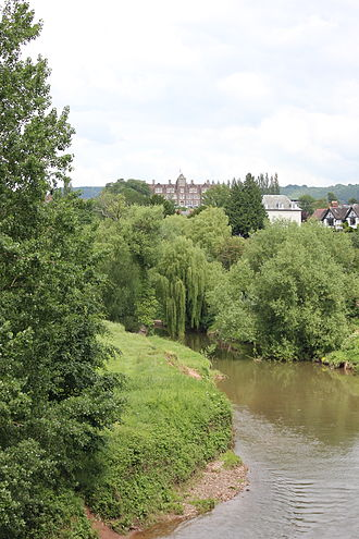 Haberdashers' Monmouth School for Girls - View of the school (centre building) from Monmouth town centre, River Monnow in foreground