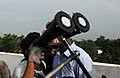 Viewers enjoying the moments of the Eclipse through the telescope at Taregna near Patna on July 22, 2009.jpg