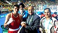 Vijay Goel greeting the Indian Boxer Manoj Kumar (64 kg category) after he defeated Petrauskas E. of Lithuania, at Rio.jpg