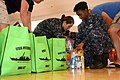 Volunteers organize donated items at the Hawk's Nest Training Center at Fleet Activities Yokosuka. (35238158812).jpg