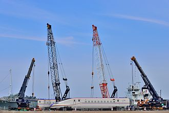 W7 Series Shinkansen - Cars of the first set, W1, being unloaded at Kanazawa Port in April 2014