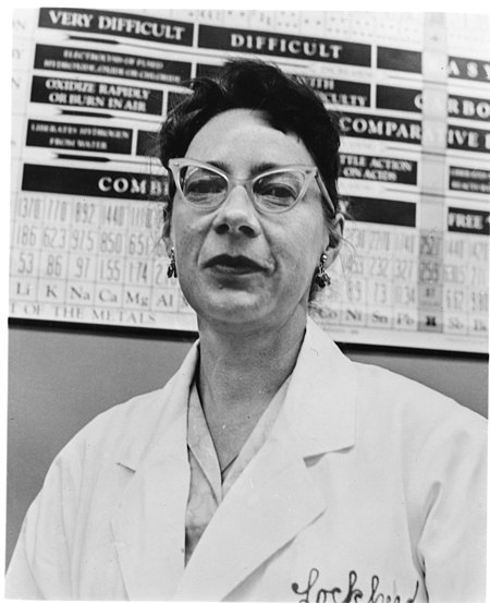 c8906623690f Woman wearing cat eye glasses in the 1960s