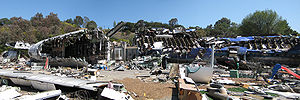 War of the Worlds (2005 film) - Destroyed Boeing 747 used on the War of the Worlds set. Currently, visitors can view the destroyed airliner set during the Universal Studios Hollywood's Studio Tour.