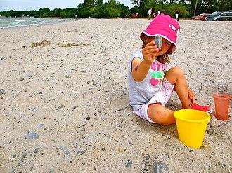 Wellington, Ontario - Child at Play on Wellington Beach