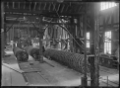 Wheels for ammunition wagons, in one of the Petone Railway Workshops. ATLIB 287404.png