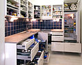White kitchen with cabinet doors and drawers opened or removed so that real-life stuff can be seen in cabinets.jpg