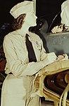 Woman (left) detail from Eloise J. Ellis right now keeps em flyin 1a34887v (cropped).jpg