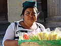 Woman Vendor in Central Park - Antigua Guatemala - Sacatepequez - Guatemala (15919316545).jpg