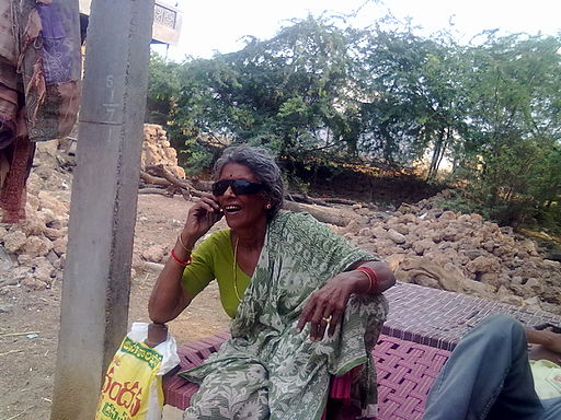 Woman talks in mobile phone in Rural Andhra Pradesh
