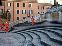 Workers cleaning the Spanish Steps in Rome at the start of a day