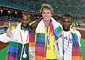 XIX Commonwealth Games-2010 Delhi Winners of 100m (Men's T46) Patmore Simon of Australia (Gold), Radebe Samkelo Mike of South Africa, (Silver) and Abdullahi Ayuba of Nigeria (Bronze), during medal presentation ceremony.jpg