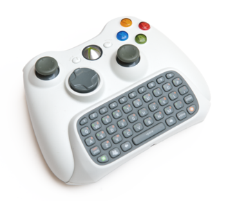 Xbox 360 Chatpad from the Messenger Kit attached to a wireless controller Xbox 360 Chatpad+controller.png