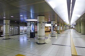 Yabachō Station - Station concourse with the mechanical water clock on the left side