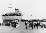 The first American war dead were brought home aboard the USS Randall, shown here departing Yokohama on March 23, 1953