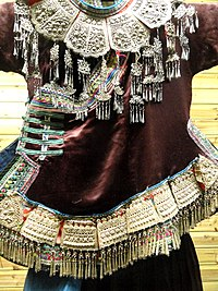 Zhuang woman embroidered, silver-ornamented dress detail - Yunnan Nationalities Museum - DSC04251.JPG